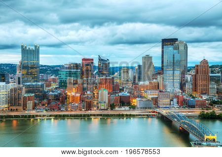 Pittsburgh cityscape with the Ohio river in the evening