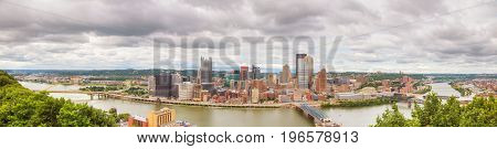 Panoramic aerial overview of Pittsburgh on a cloudy day