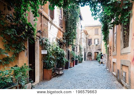 Rome Italy - August 20 2016: Picturesque pedestrian street in Trastevere a sunny summer day in Rome