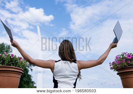 Success in e-commerce. Internet business. Successful woman took vacation, blue sky background