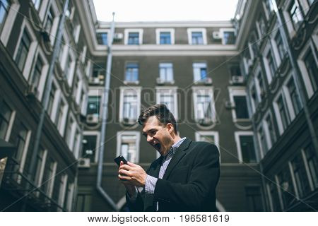 Social influence on successful businessman. Happy adult man and people's impact on background, telecommunication and mixed emotions