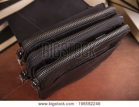 Men's leather bag with zippers closed; Three department bags; Closed close-up zipper