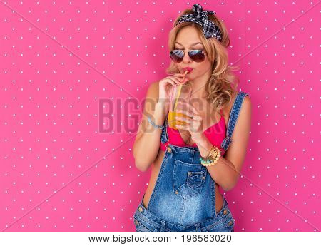 Young sexy woman drinking juice or cocktail in underwear bra Outdoors, lifestyle