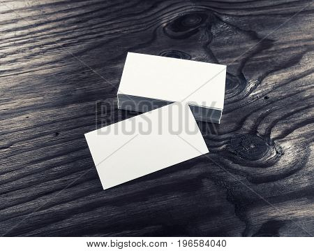 Photo of blank white business cards on wood background. For design presentations and portfolios. Mock-up for branding identity. Top view.