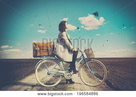 Portrait Of A Young Woman With A Bicycle And Suitcase