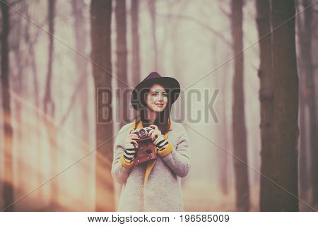 Portrait Of A Young Woman With A Camera