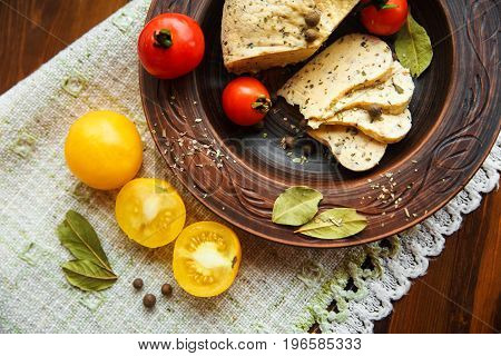 homemade cheesetomatos with herb spice in rural pottery.rough table napkin