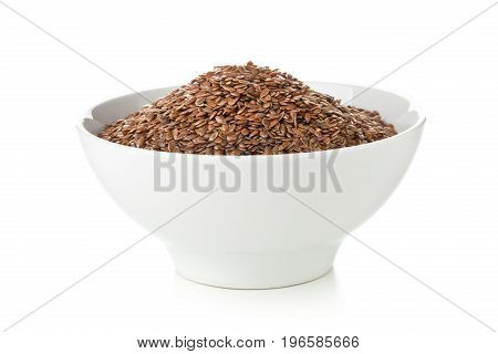 Uncooked raw linseed or flax seed in white bowl over white background