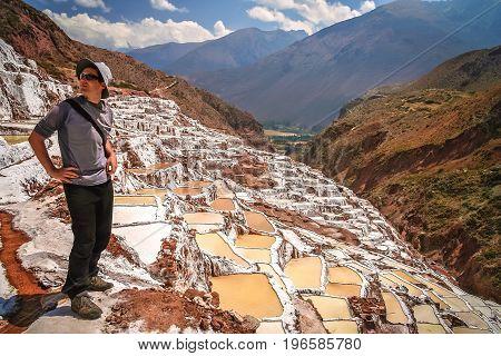 Tourists admiring the traditional salt mine  salinas  in Maras, Peru, South America