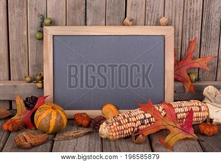 Colorful autumn objects around a blank chalk board for copy space