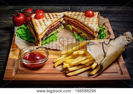 Healthy tuna panini sandwiches with french fries