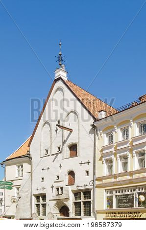 Tallin, Estonia-July 7, 2017: Old warehouse in Tallin with decorative metal supports holding the building together, hoist for lifting goods to upper stories