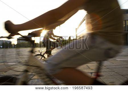 kid cycling sunset