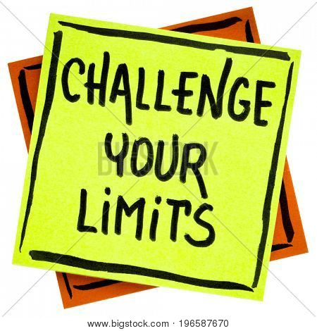 challenge your limits inspirational advice or reminder - handwriting in black ink on an isolated sticky note