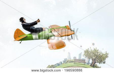 Woman in drawn airplane