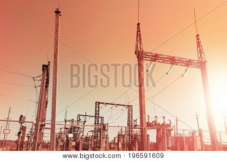 Electrical substation on sky background at sunset