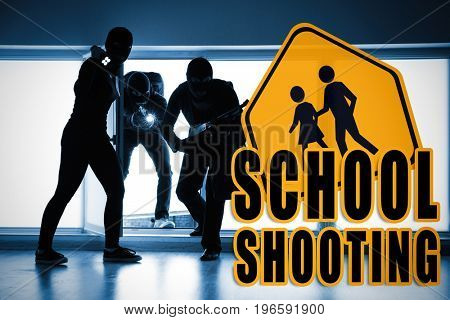 Terrorists entering classroom trough window at night. School shooting concept