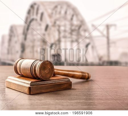 Judge's gavel and bridge on background. Concept of law