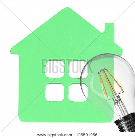 Model of house and light bulb on white background. Concept of energy consumption