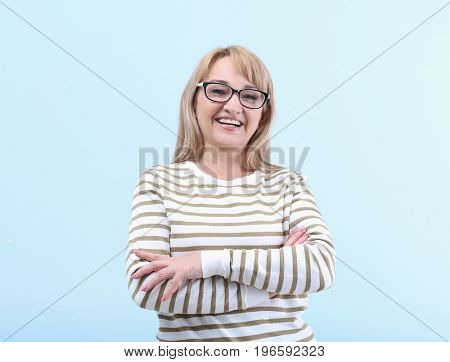 Portrait of  mature woman on light blue background