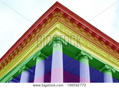 Courthouse with colors of gay flag on sky background. LGBT rights concept