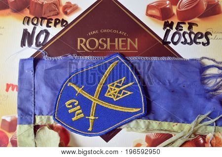 ILLUSTRATIVE EDITORIAL.Chevron of Ukrainian Army. With logo Roshen Inc. Trademark Roshen is property of Ukrainian president Poroshenko.Incription -   No losses (RUS).Kiev,Ukraine.July 23, 2017