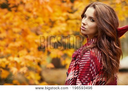 season and people concept - beautiful happy young woman walking in autumn park