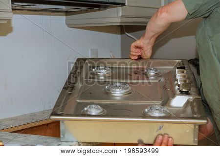 A Gas Cooker Built In A Kitchen Table.