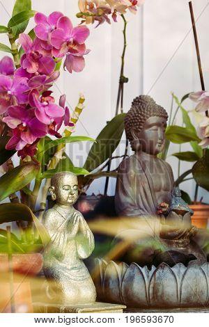 Buddha in meditation with flower