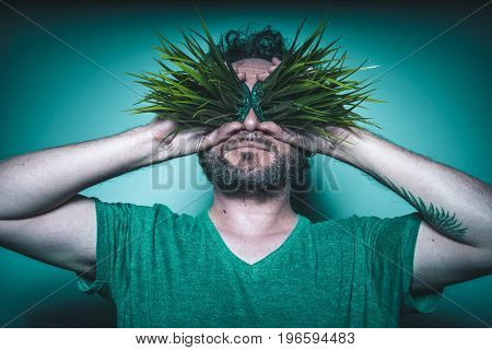 Weed, Concept of addiction to drugs, man with grass in eyes with gesture of happiness