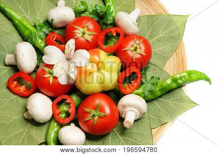Vegetables on green tropical leaves