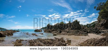 Panorama of stone seashore and blue sea New Zealand