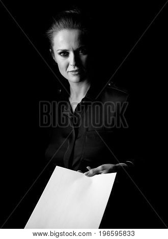 Woman In Dark Dress Isolated On Black Giving Paper Sheet