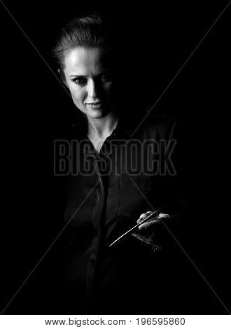 Portrait Of Woman In Dark Dress Isolated On Black Giving Pen