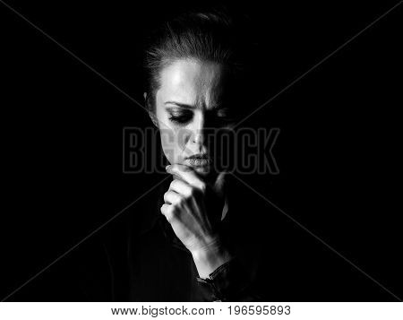 Portrait Of Pensive Woman In Dark Dress Isolated On Black