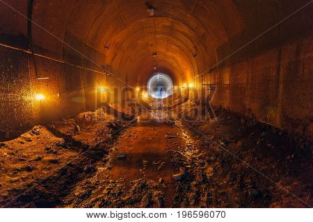 Abandoned old rusty dirty metal mining tunnel