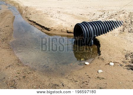 clear water waste pipe on a beach