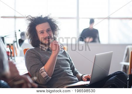 Young Entrepreneur Freelancer Working Using A Laptop And In Coworking space