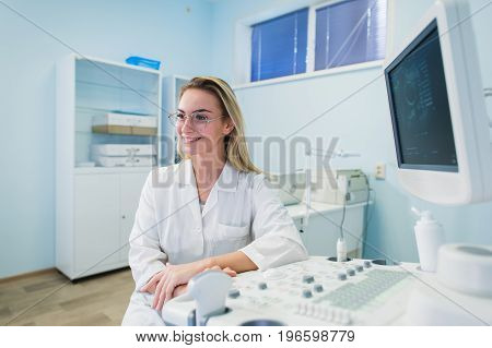 portrait of young female dentist in office smiling