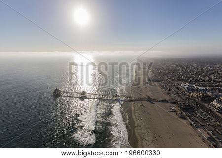 Aerial view of Huntington Beach Pier with late afternoon sun in Southern California.