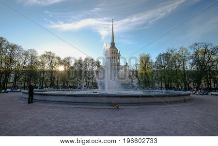 Russia Saint-Petersburg 23 MAY 2017 : The man walking at the park opposite the Saint Issac Cathedral at the evening time. And it's a good weather time for relaxing. many people at here.