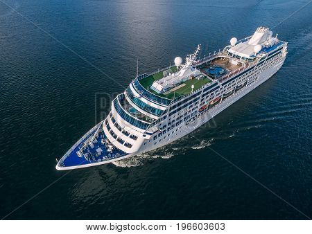 Aerial view of cruise liner sailing in the open sea
