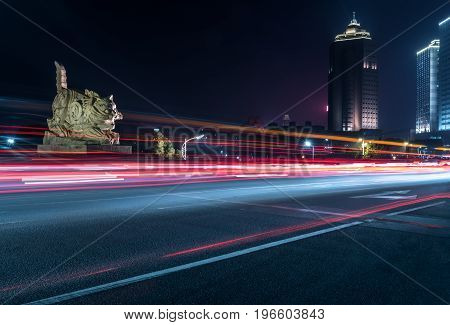 Empty downtown street intersection at nightshot in ShanghaiChina.