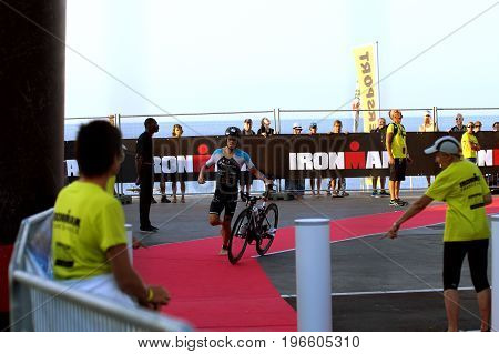 NICE - JULY 27 2017 : IRONMAN Nice 2017. MIKA Tomas finishing the swimming and starting for the 180 km bike tour