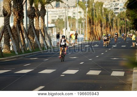NICE - JULY 27 2017 : IRONMAN Nice 2017. Competitors starting for the 180 km bike tour. Lisa FUMAGALLI (55) in the foreground