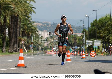 NICE - JULY 27 2017 : IRONMAN Nice 2017. Competitor during the Marathon. Laurent NOBELS (832) close to the 15 km point.
