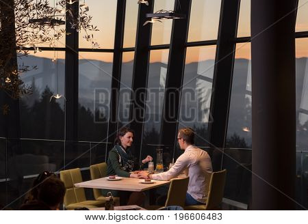 Couple celebrate Valentine's day with romantic dinner in restaurant near the window