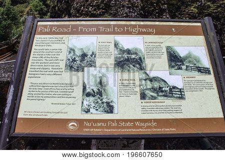 Honolulu, Hawaii, USA - May 29, 2016: Information board located at the Nuuanu Pali Lookout detailing the history of the Pali Road - From Trail to Highway