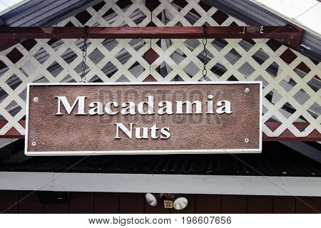 Honolulu, Hawaii, USA - May 29, 2016: Hanging Sign at the Tropical Farms Macadamia Nut Outlet