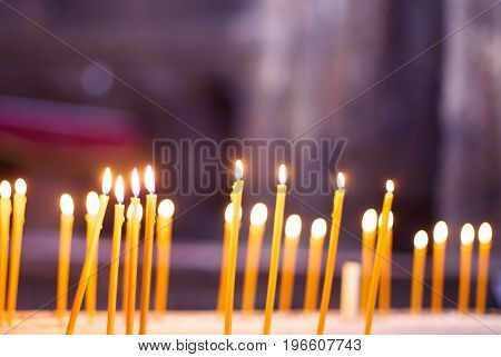 Long thin burning candles in Orthodox Church